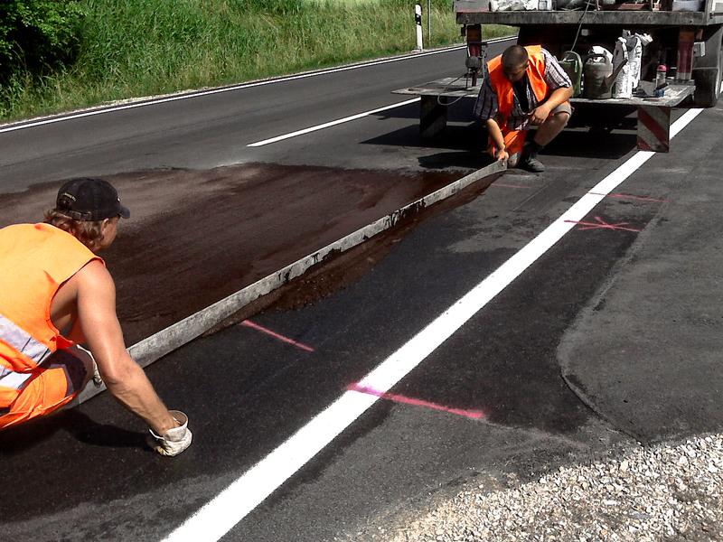 Large fluessig asphalt senkenausgleich